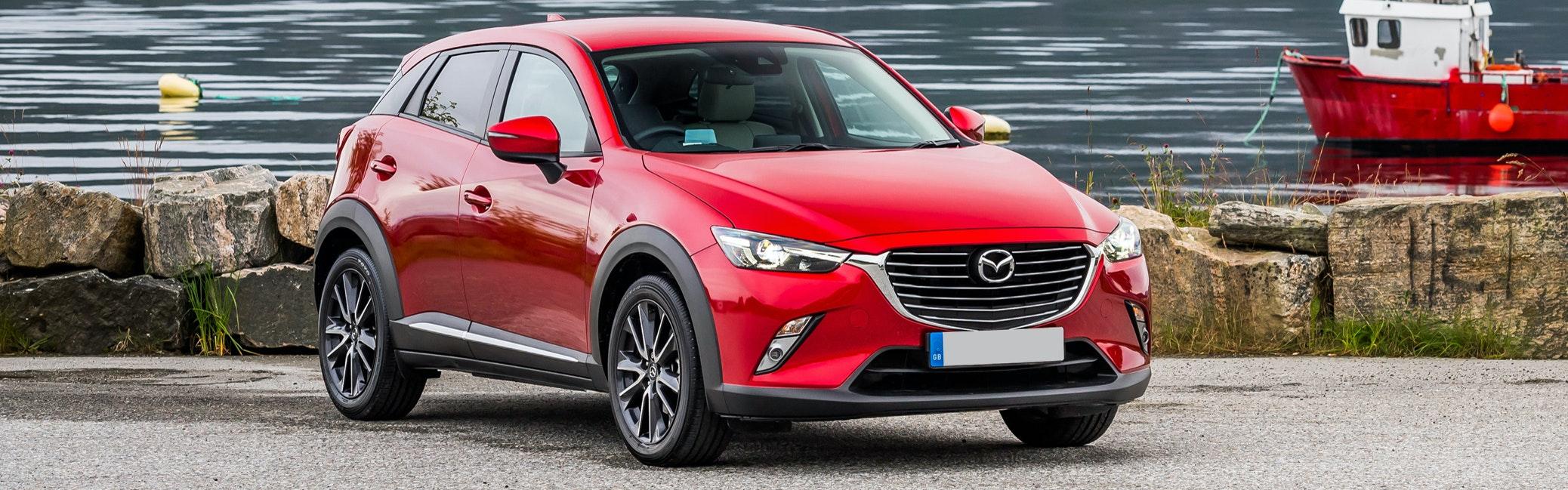 Red Mazda CX-3 parked, viewed from the front