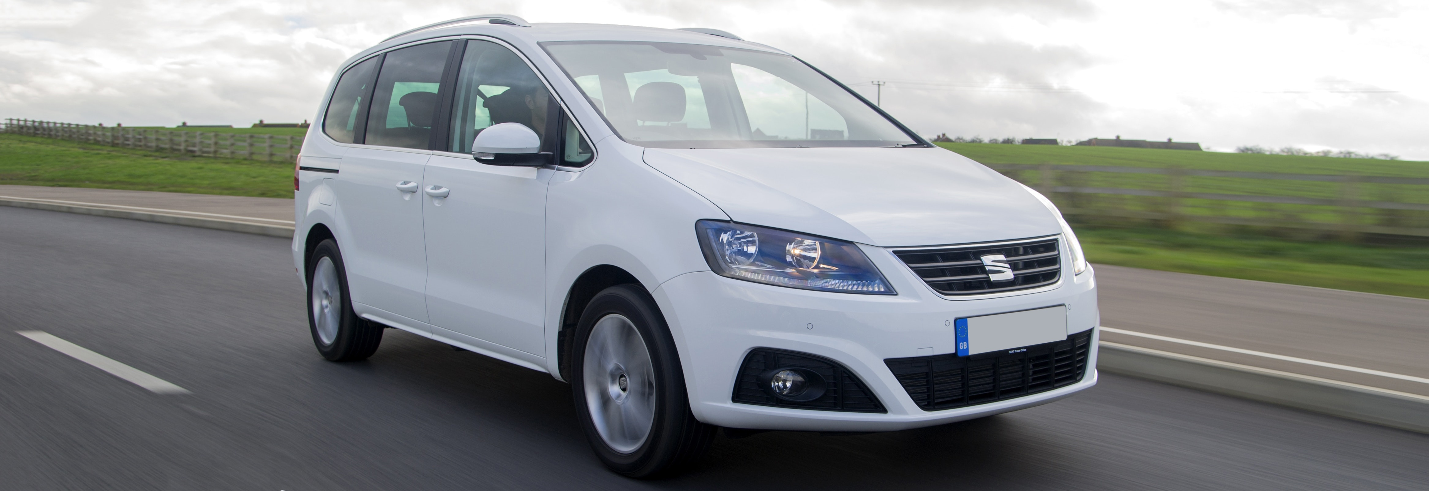 White SEAT Alhambra Driving, Viewed From The Front