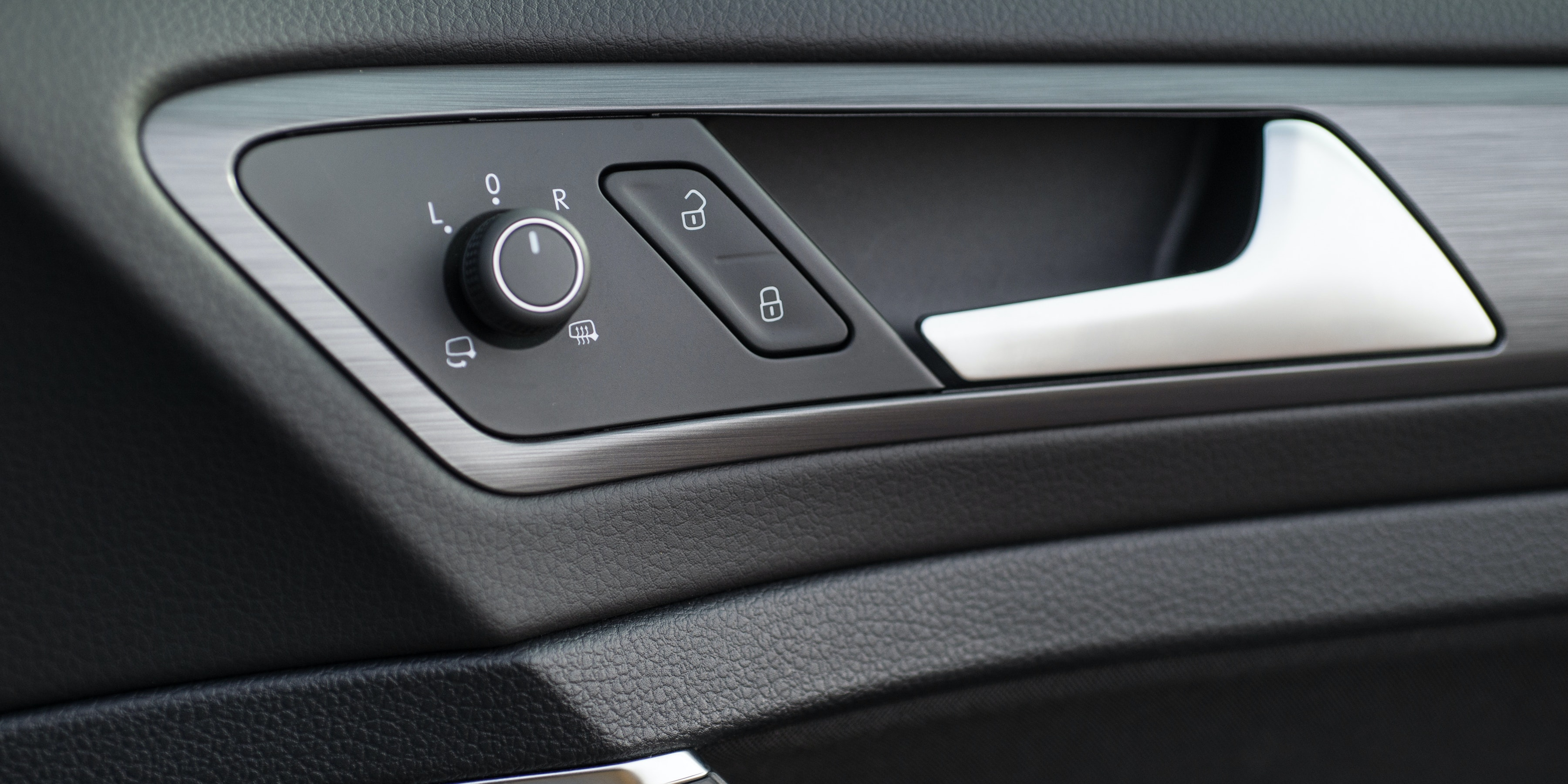 For the R, the regular Golf's dash is livened up with carbon fibre-effect trim pieces