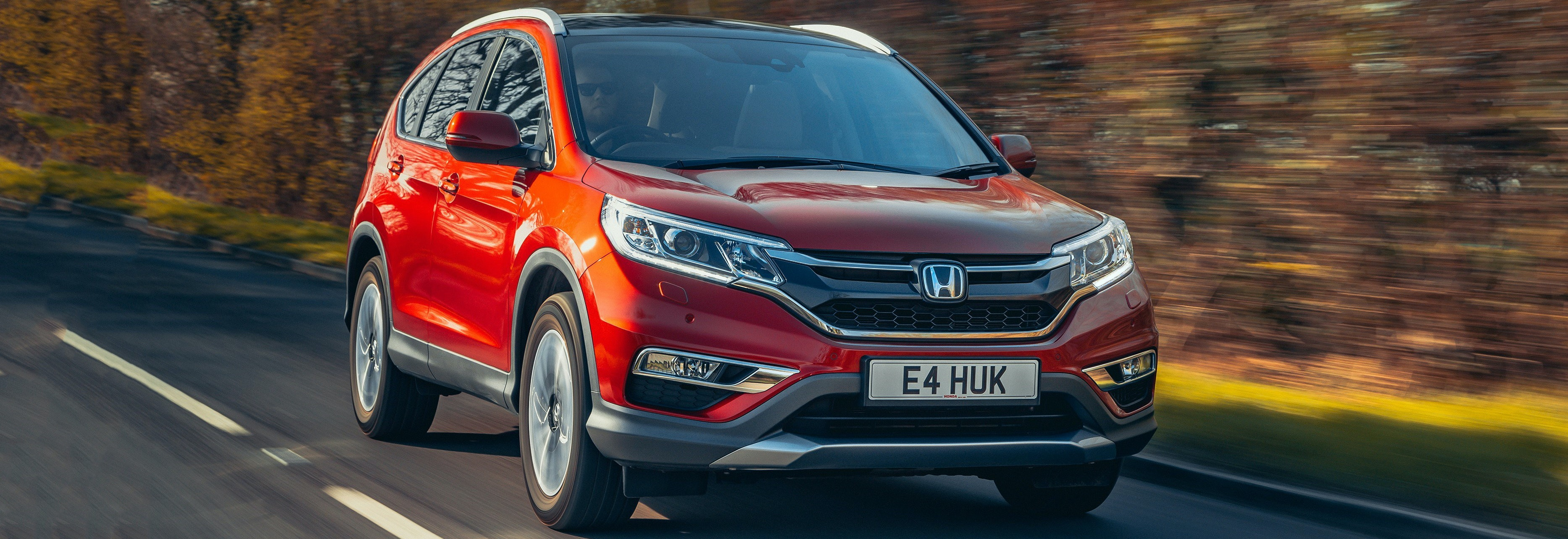 honda cr v red driving front