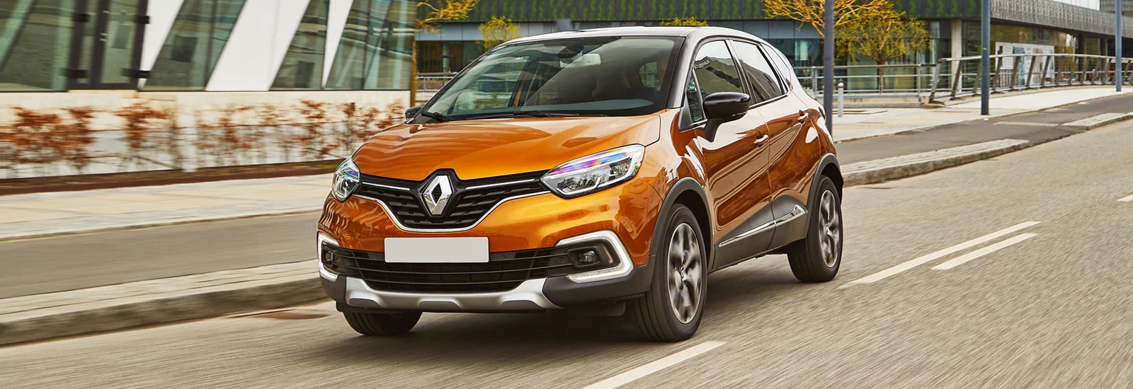 Orange Renault Captur driving, viewed from the front