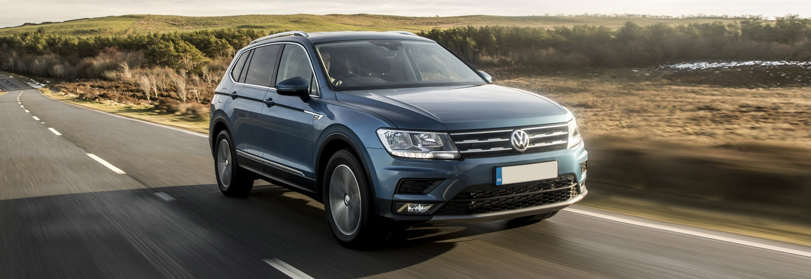 Blue Volkswagen Tiguan Allspace driving, viewed from the front